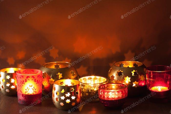 burning christmas lanterns and decoration lights background