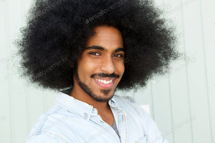 smiling man with beard and afro