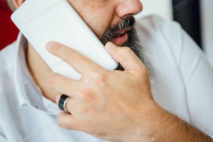 Close-up of man phoning