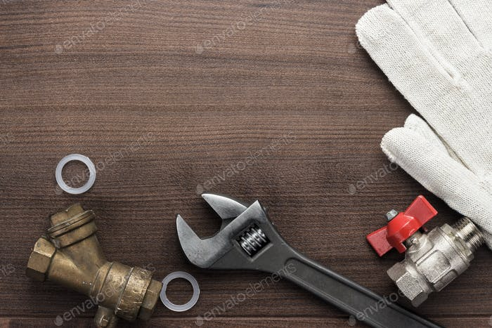 Adjustable Wrench And Pipes