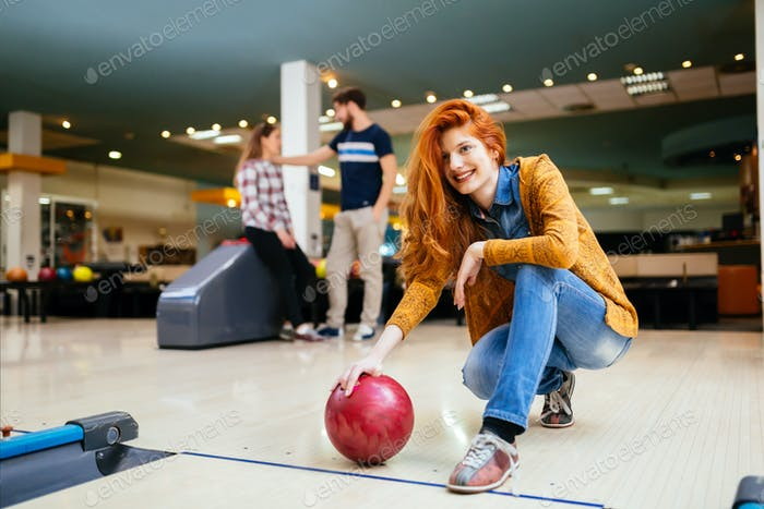 Friends having fun while bowling