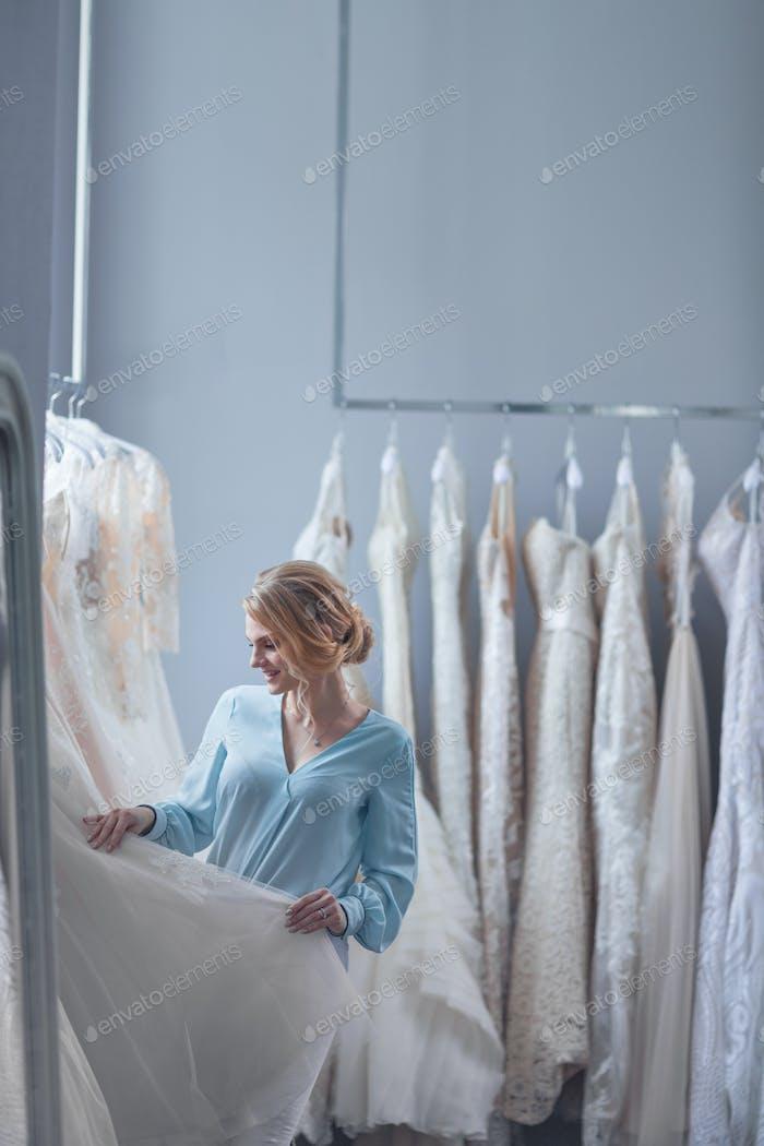 Young woman choosing a wedding dress