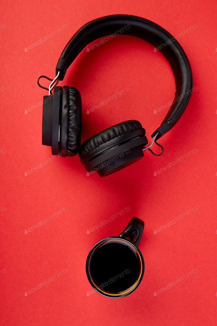 Black Headphones and cup of coffee
