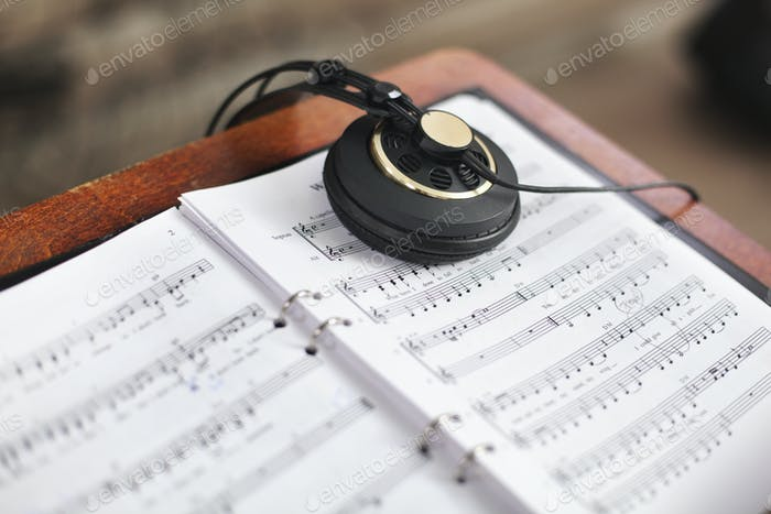 Headphones on music sheet