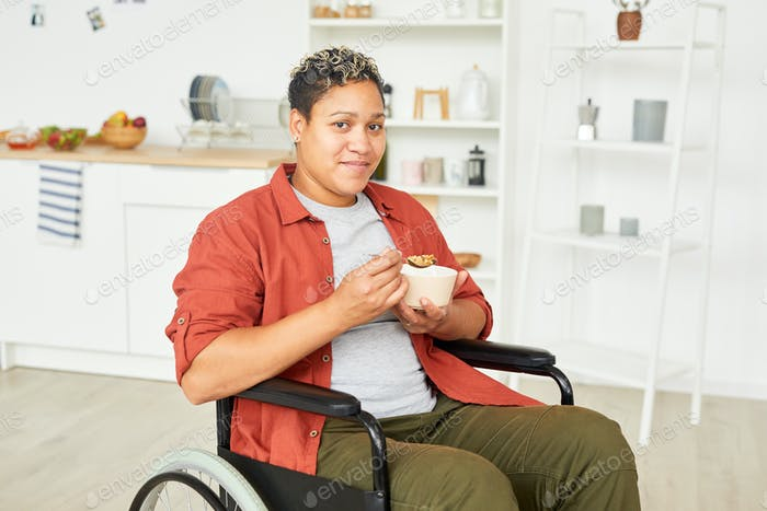 Disabled woman eating porridge