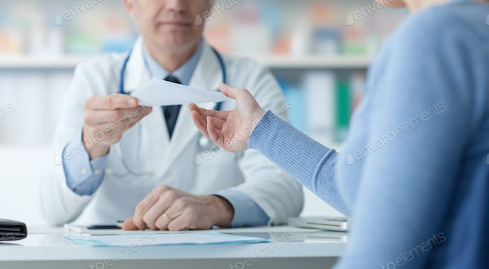 Doctor giving a medical prescription to the patient