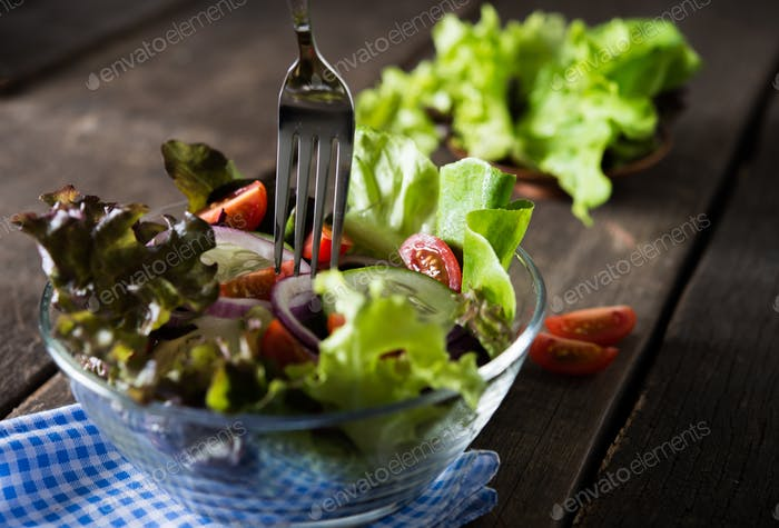 Close up of fresh vegetables salad with fork in the bowl, Ready to eat. Healthy food concept.