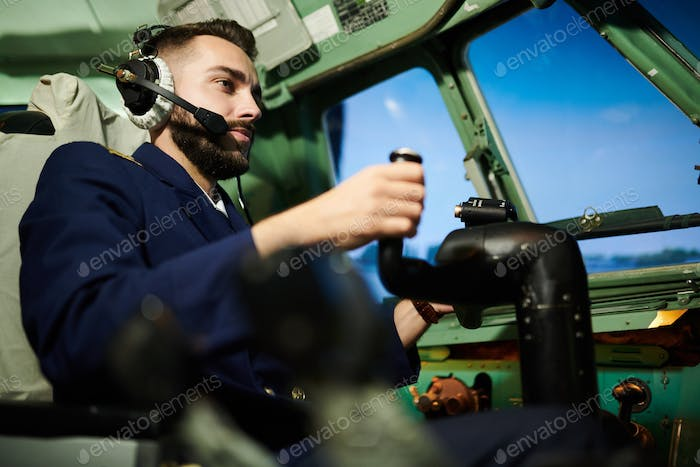 Pilot in Airplane Cabin