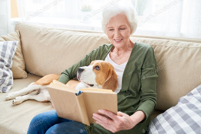 Senior Woman Relaxing at Home with Pet