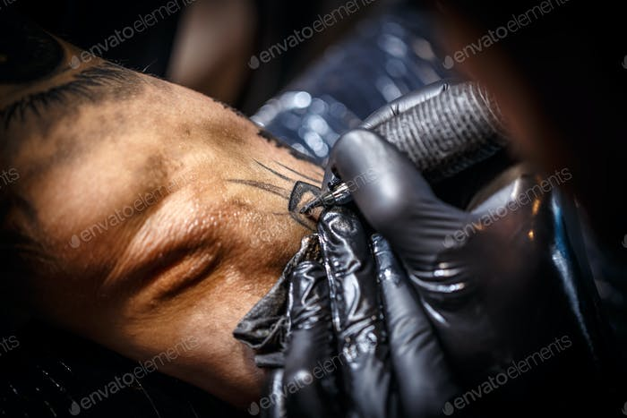 Man creating tattoo