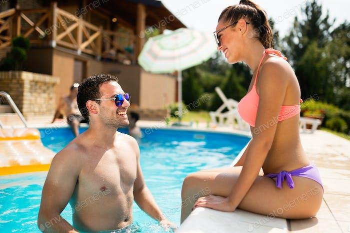 Couple enjoying summer in pool