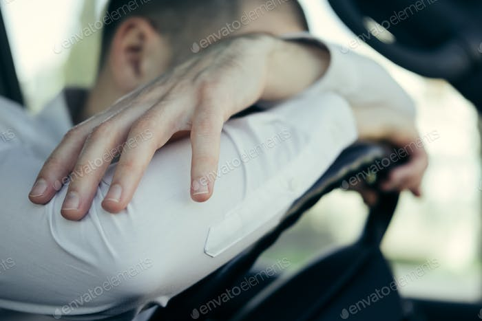 Stressed and furious driver in his car