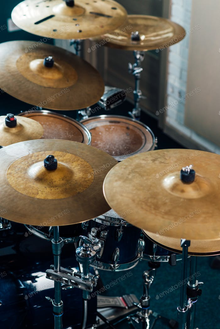 Crash, ride, perforated cymbals in a drum kit. Percussion musical instruments.