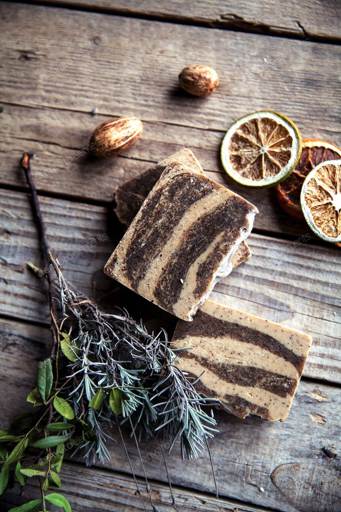 Natural cosmetics. Organic scrub soap on wooden background. Purification, healthy skin