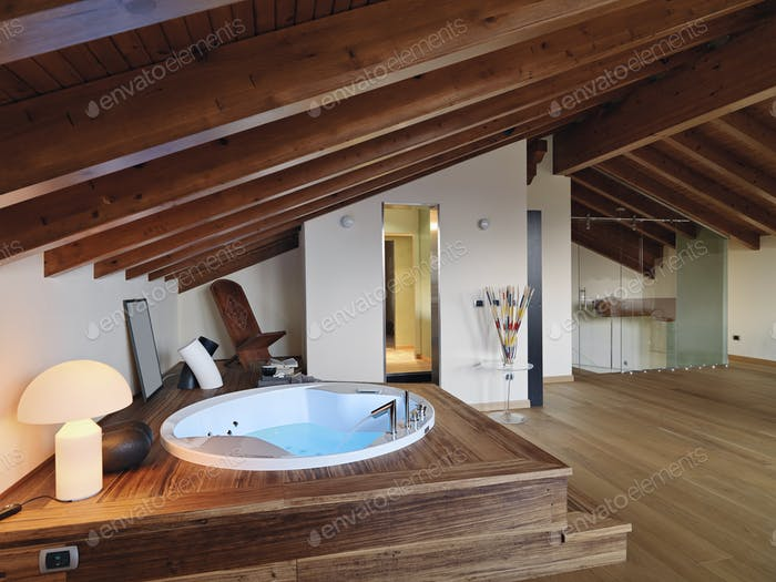 Interiors of the Modern Bathroom in the Attic