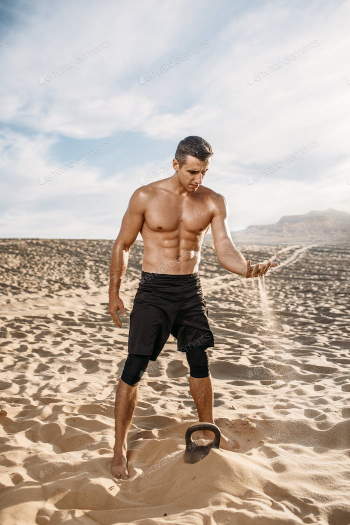 Sportsman after workout in desert at sunny day