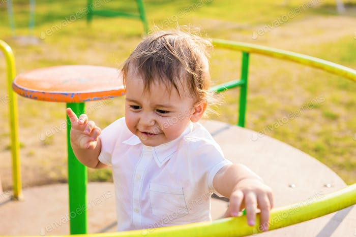 happy child playing at a playground.