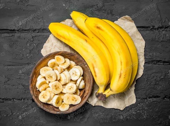 Bananas on grey paper.
