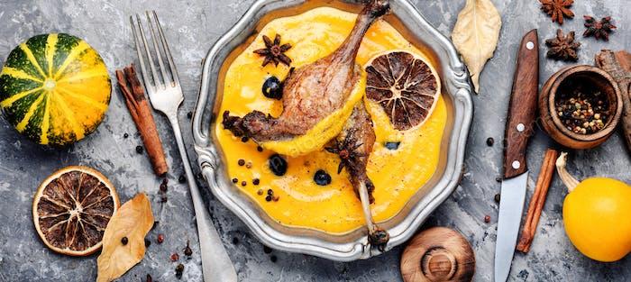 Baked duck leg in pumpkin puree