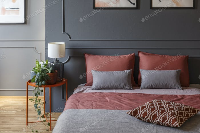 Pink and grey hotel bedroom
