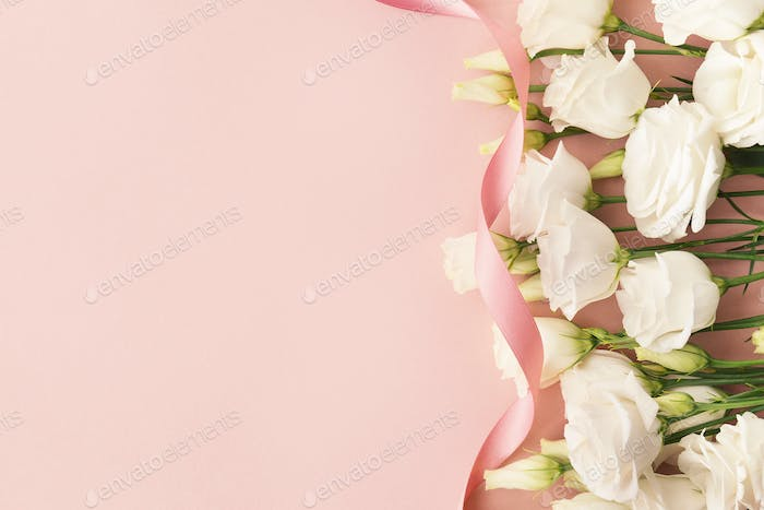White roses and pink ribbon