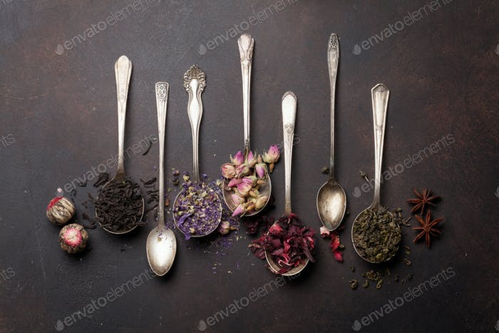 Various tea in spoons. Black, green and red tea