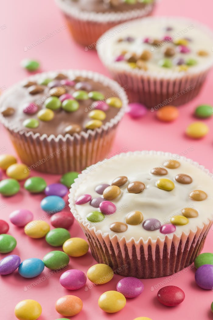Sweet cupcakes with candies.