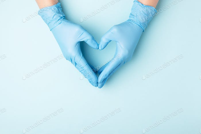Doctor's Hands in Medical Gloves in Shape of Heart.