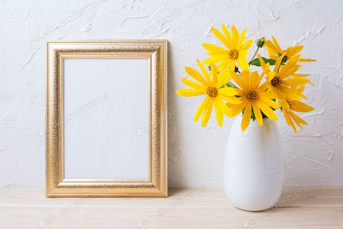 Golden frame mockup with yellow rosinweed flowers in vase