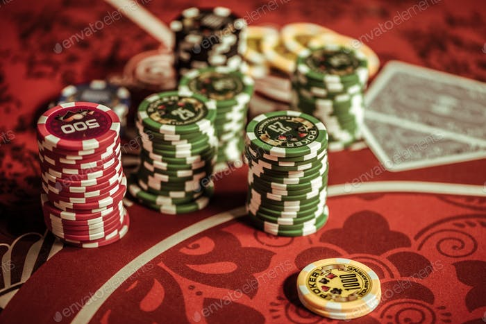 top view of poker chips on table in casino