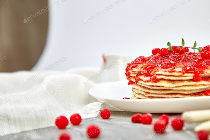 American pancake with jam - berry, viburnum, cranberry