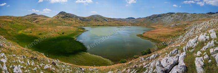 Panoramic photo of Stirinsko lake in Dinaric Alps