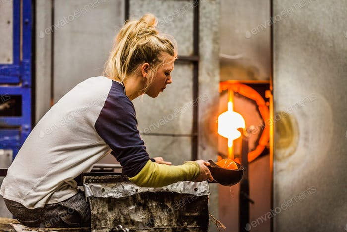 Blowing Glass Professional Woman Working on a Vase.