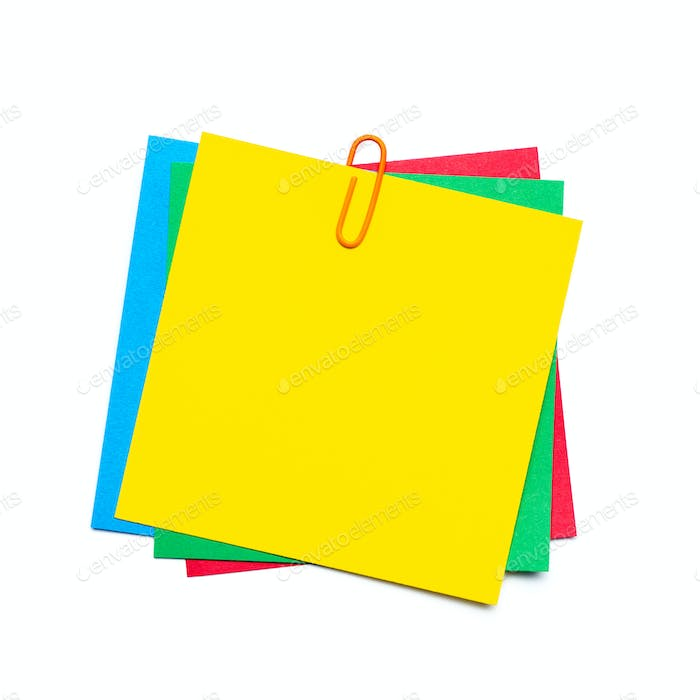 Yellow stick note with paper clip isolated