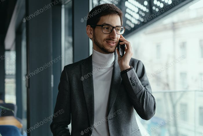 Portrait successful business man talking on the smartphone