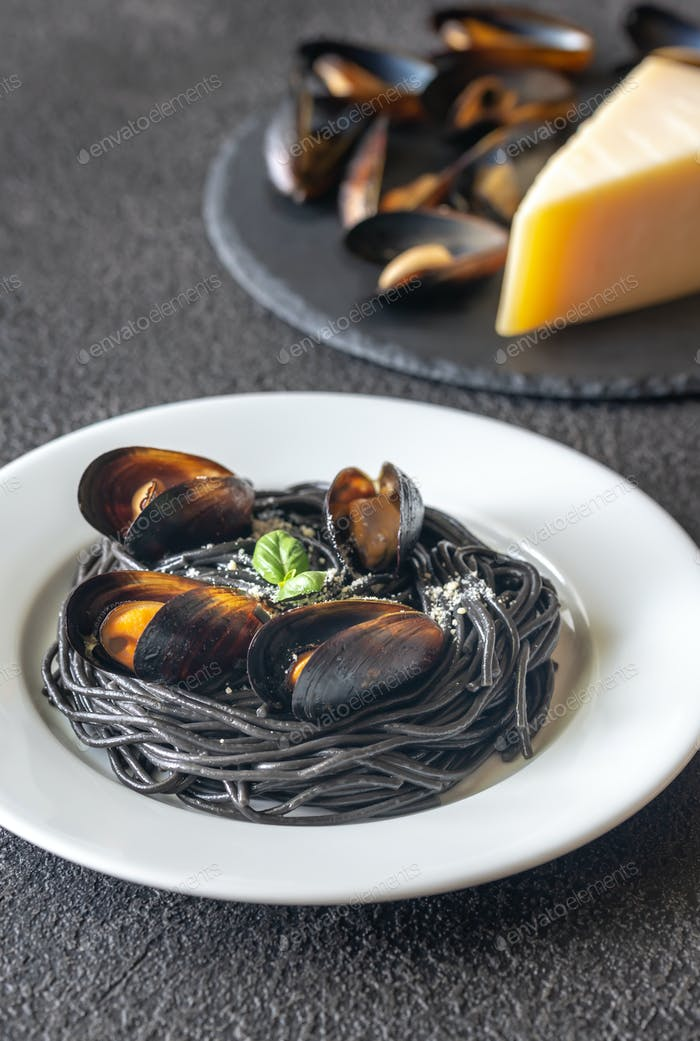 Black pasta with mussels and parmesan