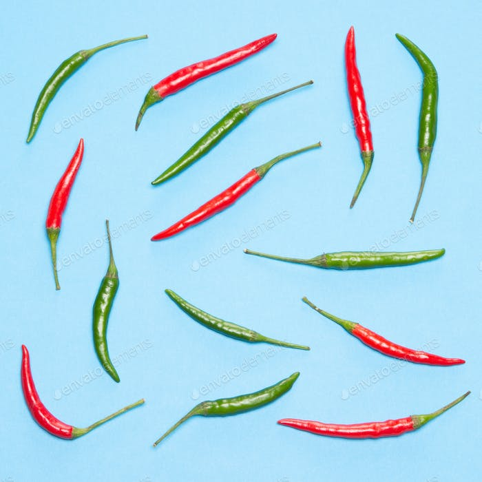 Food flatlay pattern of chili peppers on blue background