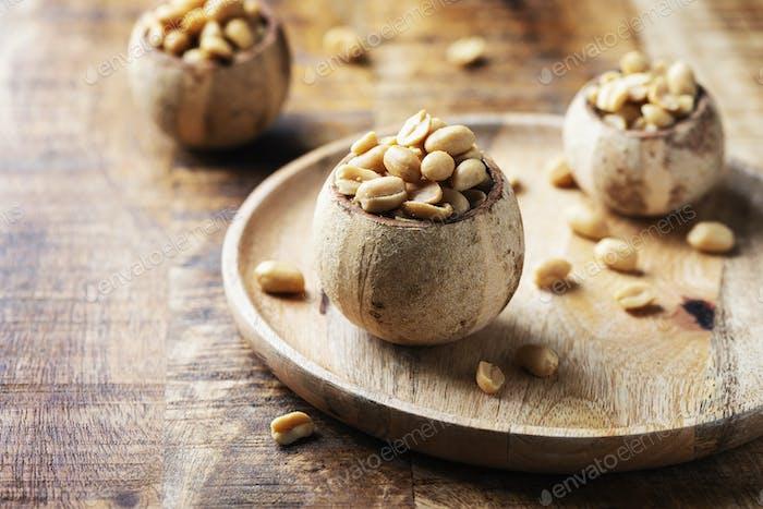 Salt peanut on the wooden table