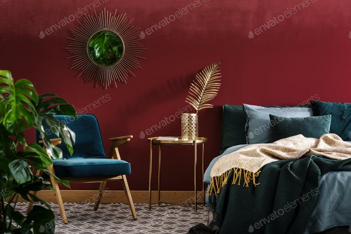 Sophisticated red bedroom with mirror