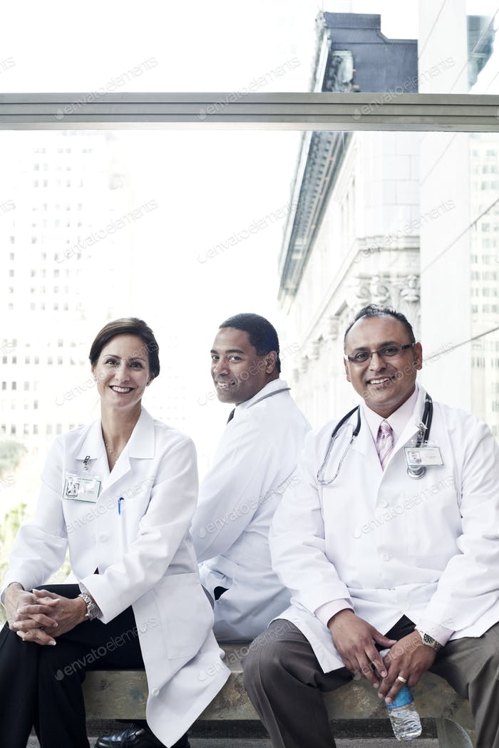 Mixed race group of doctors in lab coats.