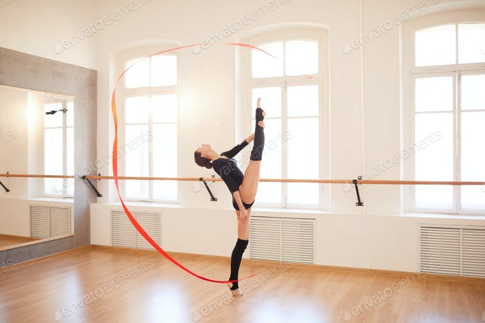 Flexible girl performing with ribbon
