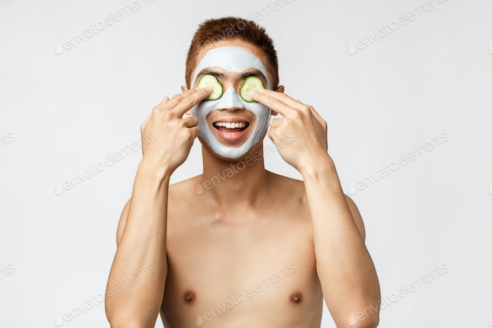 Beauty, skincare and spa concept. Portrait of enthusiastic, relaxed asian naked man enjoying