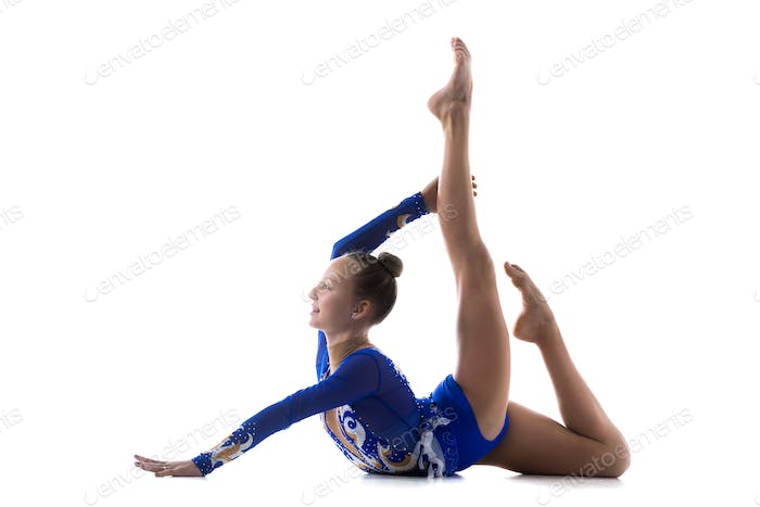 Flexible girl doing acro exercise