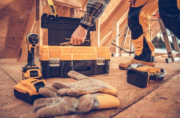 Wood Frame Construction Worker Taking Large Screws