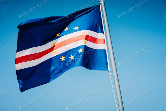 Cape Verde flag waving on the mast with blue sky background