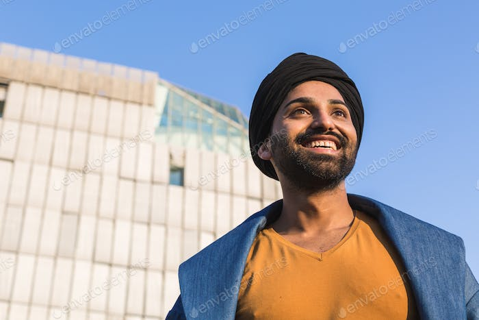 Young Indian man posing in an urban context