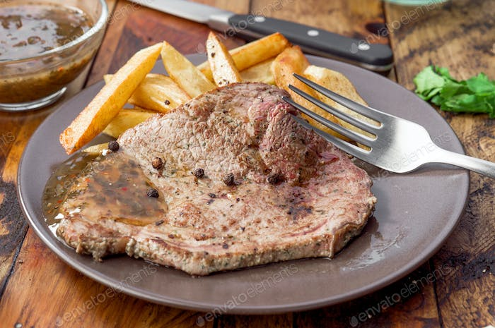 grilled beef steak with chips