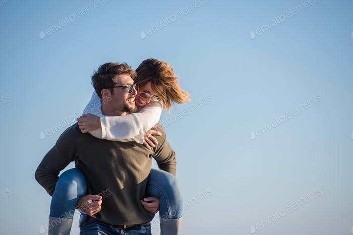 couple having fun at beach during autumn