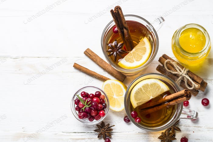 Autumn or winter hot tea with fruit, berries and spices