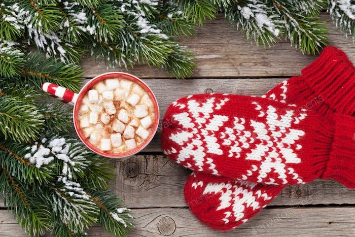 Christmas fir tree, mittens, hot chocolate
